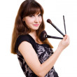 Portrait of beautiful woman with brushes — Stock Photo