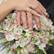 Wedding bouquet and hands — Stock Photo