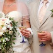 Newly-married couple with a champagne glass — Stock Photo #5088296