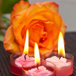 Royalty-Free Stock Photo: Candles against a rose