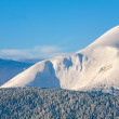 Snowy sunrise mountain landscape — Stock Photo