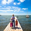 Family on wooden pier — Stock Photo #4471540