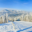 Winter mountain landscape with ski lift and skiing slope. — Stock Photo #4477883