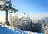 Winter morning and ski lift — Stock Photo