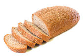 Loaf and slices of whole rye bread — Stock Photo