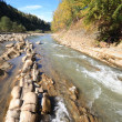 Autumn mountain stony river — Stock Photo