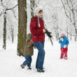 Family in winter park - Stock Photo