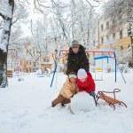 Family in winter park — Stock Photo #4537840