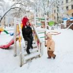 Family in winter park — Stock Photo #4537853