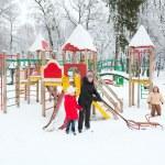 Family in winter park — Stock Photo #4537943