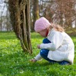 Small girl in spring park — Stock Photo