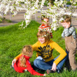 Family in spring park — Stock Photo #4545292