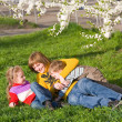 Family in spring park — Stock Photo