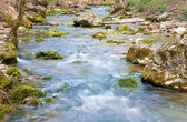 Ripples on mountain river — Stock Photo