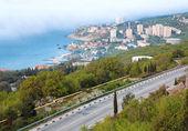 Road on spring sea coastline — Stock Photo