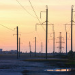 Sunset and high-voltage line — Stock Photo
