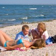 Family on beach — Stock Photo #4565043