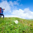 Womwith tourist knapsack on mountain — Stock Photo #4576697