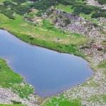 Alpine lake Brebeneckul on summer mountains — Stock Photo