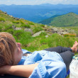 Stock Photo: Womresting on mountain top