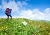 Woman with tourist knapsack on mountain — Stock Photo