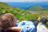 Woman resting on a mountain top — Stock Photo