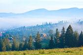 Misty mountain village — Stock Photo