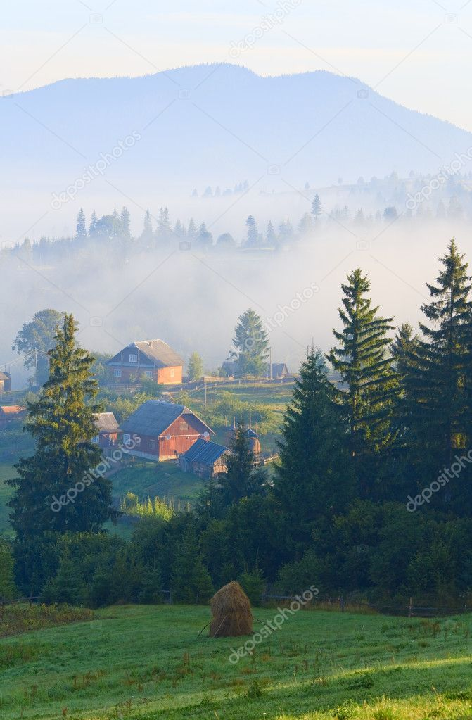 Summer misty mountain village (countryside landscape)  Stock Photo #4578039