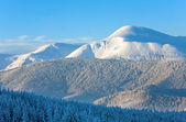 Snowy sunrise mountain landscape — Стоковое фото