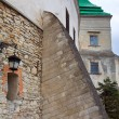 Stony wall with window and lamp (Olesko Castle, Ukraine) - Stock Photo