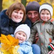 Family in autumn park — Stock Photo #4595561