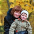 Family in autumn park — Stock Photo #4595564