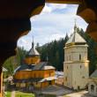 Christian monastery view through the wooden window — Stock Photo