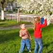 Children in spring park — Stock Photo