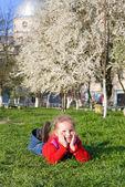Small girl in spring park — Stock Photo
