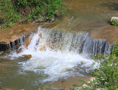 Small waterfall on spring river — Stock Photo