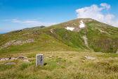 Stony post on summer mountain pidge — Stock Photo