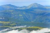 Summer cloudy mountain landscape — Stock Photo