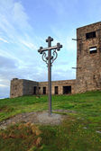 Sunrise mountain observatory ruins view with christianity cross — Stock Photo