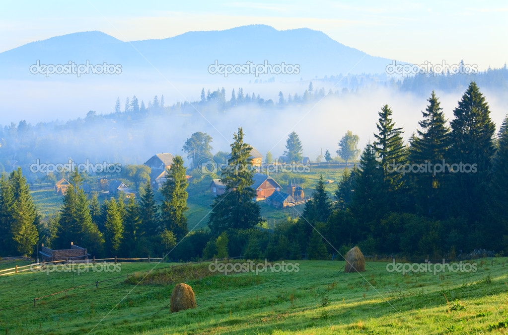 Summer misty mountain village (countryside landscape) — Stock Photo #4659660
