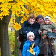 Family in autumn park — Stok fotoğraf