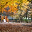 Stock Photo: Autumn park and children's playground