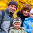 Family in autumn park — Stock Photo #4660615