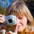 Woman making photos  on autumn forest — Stockfoto