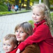 Family in autumn park — Stock Photo #4665650