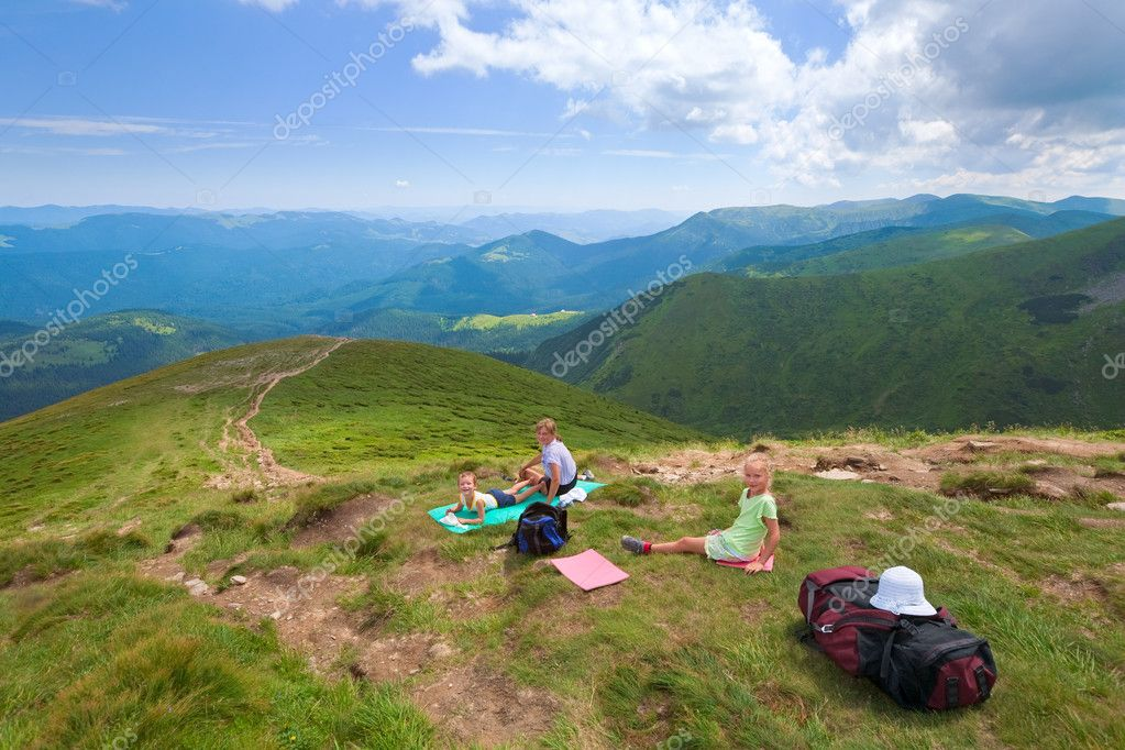 Family resting in a summer mountain walk (Goverla Mount, Ukraine)  Stock Photo #5044992