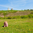 Small girl on spring blossoming field — Stock Photo #5083205