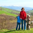 Tourist family and spring mountain country valley view — Stock Photo