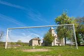 Old church and football goal (Sydoriv village, Ternopil region, — Stock Photo