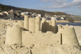 Sandcastle at seaside town — Stock Photo
